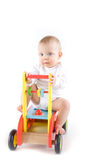 Cute baby on wooden car Royalty Free Stock Images