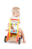 Cute baby on wooden car Stock Photo