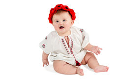 Cute baby with wreath of poppies sitting Royalty Free Stock Image