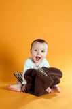 Cute baby on yellow Royalty Free Stock Images