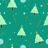 Cute background of Christmas trees and candy on the background Royalty Free Stock Photos