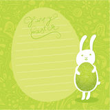 Cute  background. Easter bunny hold ornate easter egg. Stock Image