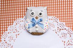 Cute background with honey-cake owl Stock Images