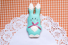 Cute background with a honey-cake rabbit Stock Images