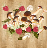 Background with raspberry and mushrooms on a hardwood texture Royalty Free Stock Photography