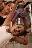 Cute Ballerina Bends Sideways Stock Photo