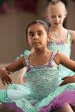 Cute Ballerina Friends. Two little girls in ballet dresses practice in a studio Stock Photo