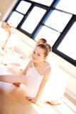 Cute Ballerina Splitting her Legs on the Floor Stock Photo