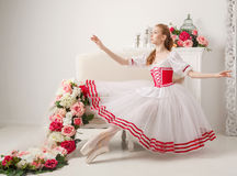 Cute ballerina and spring flowers Royalty Free Stock Photography