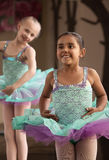 Cute Ballerinas Laughing. Two little ballet students practicing while laughing Royalty Free Stock Image