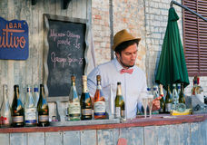 Cute bartender pours sparkling wine Royalty Free Stock Image