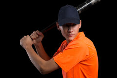 Cute baseball player bat preparing to strike Stock Photo