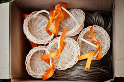 Cute basket with ribbon souvenir in the box Stock Photos