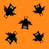 Cute bats on orange background. Happy Halloween pattern. Stock Photo