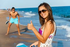 Cute beach tennis player doing thumbs up. Royalty Free Stock Photo