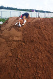 Cute Beagle Dog resting. Atop mount of dirt Stock Photo