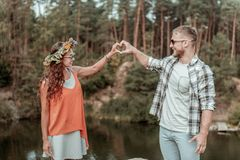 Cute beaming couple wearing sunglasses feeling extremely happy traveling together. Traveling together. Cute beaming couple wearing sunglasses feeling extremely stock image