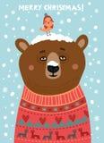 Cute bear with a bird. Christmas card Royalty Free Stock Photography