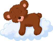 Cute bear cartoon sleeping on the cloud Stock Image