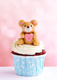 Cute bear cupcake on pink background Stock Image