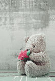 Cute bear doll holding rose bouquet Royalty Free Stock Images