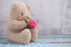 Cute bear doll holding rose bouquet Stock Images