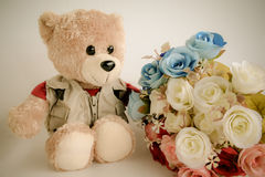 Cute bear doll with rose bouquet Stock Photography