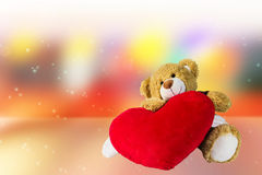 Cute bear doll sit with red heart in dreamy sweet empty area bac Royalty Free Stock Photo