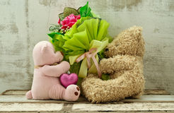 Cute bear dolls holding roses bouquet Royalty Free Stock Photography