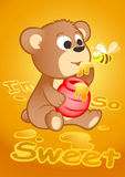 Cute bear eating honey with a bee Stock Photos