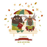 Cute bear and funny elk reading books on bench Royalty Free Stock Photography
