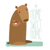 Cute bear holding a house, with lettering Stock Image