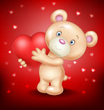 Cute bear holding red heart Stock Photo