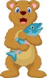 Cute bear holding salmon fish Royalty Free Stock Photography