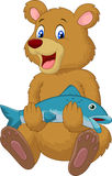 Cute bear holding salmon fish Royalty Free Stock Image