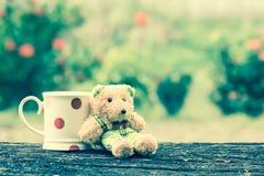 Cute bear and mug Royalty Free Stock Photography