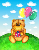 Cute bear sitting on grass with balloons Royalty Free Stock Photo
