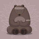 Cute bear sitting in yoga lotus pose Royalty Free Stock Image