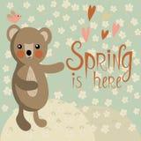 Cute bear on a spring meadow Stock Photo