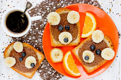 Cute bear toast with chocolate banana and blueberry - creative f Royalty Free Stock Photo
