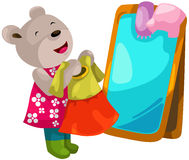 Cute bear trying on dresses Stock Photography