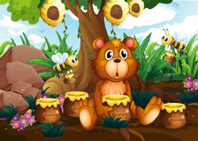 A cute bear under the tree with bees and pots of honey Royalty Free Stock Photos