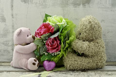 Cute  bears holding roses bouquet Royalty Free Stock Image