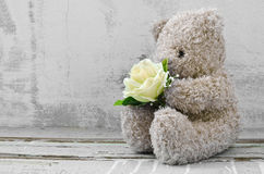 Cute  bears holding roses bouquet Stock Image