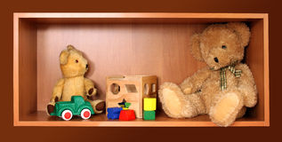 Cute bears on the shelf Royalty Free Stock Image