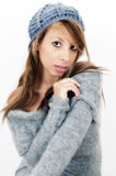 Cute and Beautiful. An alluring three quarter length portrait of an olive skinned model wearing a grey woolen hat and top with a white background Stock Photos