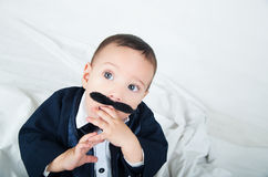 Cute beautiful baby boy in costume with mustache Royalty Free Stock Images