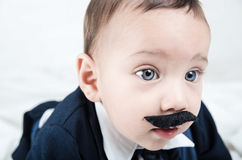 Cute beautiful baby boy in costume with mustache Royalty Free Stock Photos