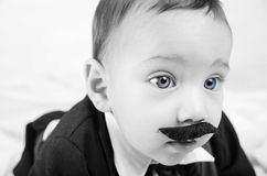 Cute beautiful baby boy in costume with mustache Royalty Free Stock Image
