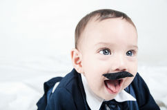Cute beautiful baby boy in costume with mustache Stock Photography